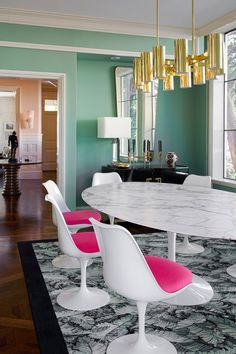 The striking dining room has the perfect mix of some of Anne-Sophie's favorite pieces, like the Gio Ponti mirror and the Jacobsen light.