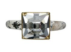 """1501-1625: """"Gold finger ring set with a large [square] table-cut diamond in enamelled gold setting, the white champleve enamel is decorated with black enamel flowers and leaves on the outer surface of the hoop and underside of the bezel."""""""