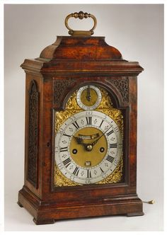 A superb George I arched dial burr walnut table clock by this well-known Hugeonot maker, the 8-day movement with inset datework, dummy pendulum and rise/fall in the arch. Height excluding handle: 15 in (38 cm) * Simon de Charmes was a Hugeonot immigrant from France and was a member of the Clockmakers' Company from 1692 – 1730. He made a number of very fine longcase and bracket clocks and this fine table burr walnut table clock is no exception. His workshop was at the 'the sign of the clock'…