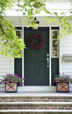 14 Front Door Colors to Boost Your Curb Appeal A hunter green door buoyed by clean, white trim will never go out of style. See more colorful doors >> Front Door Paint Colors, Best Paint Colors, Painted Front Doors, Front Door Planters, Front Door Decor, Door Entryway, Door Design, House Design, Green Shutters