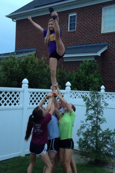 Backyard cheerleading = @Courtney Baker Baker Erickson @Julia Kohler @Emily Schoenfeld Schoenfeld Mahrer