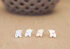 "* Dainty elephant stud earrings - available in 2 colors - silver and gold * Size: 0.7"" by 0.7"" * Please note that the dark spots shown in the pictures are shadows, not damages :) * Items will be shipp"