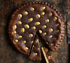 A slice of showstopping Easter chocolate tart is the perfect way to finish a meal. This simple golden egg filled dessert is easier than you think