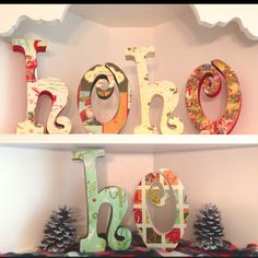 Wood letters, paint, scrapbook paper and modge podge and voila!