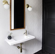 White herringbone tile, black floor tile