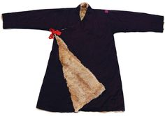 Tibetan Khampa man's coat (Chuba), hand woven fine cotton twill, Lynx fur lining, silk ties.  (Few small holes and small patch.)  Kham, Tibet 20th C., Length 140cm.