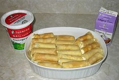 """Nalysnyky , or in our family, """"Mutty's Cheese Crepes"""".  These are cottage cheese crepes covered in heavy cream and baked in the oven.  We fight over these every holiday meal."""