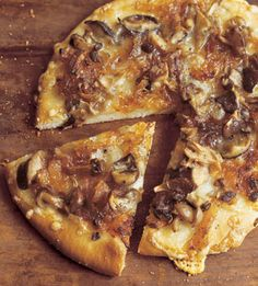 Wild Mushroom Pizza with Caramelized Onions, Fontina, and Rosemary    http://www.bonappetit.com/recipes/2004/09/wild_mushroom_pizza_with_caramelized_onions_fontina_and_rosemary