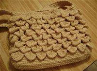 My next crochet goal... this is called a crocodile stitch pattern. Love it. Love this purse. I am going to make this but in blue I think.