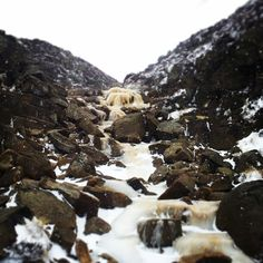 Frozen upper and moving lower waterfall , Grindsbrook Clough , Peak District
