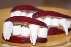 Vampire kisses: red apple slices, peanut butter and marshmallows!