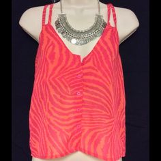 Ali & Kris Crop Top Size Small This very cute crop top by Ali & Kris is in the color orange and pink stripes.  And the size is small . Sorry no trades. Ali & Kris Tops Crop Tops