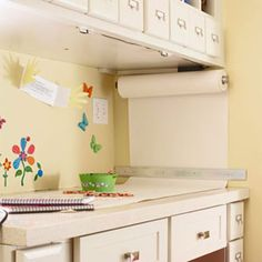 Paper dispenser in a great location. Also great disposable work area cover to protect your counter.