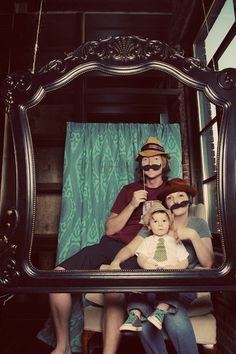 Hanging ornate frame for photo-booth setup at birthday party. Guests can use mustache, bow-tie and glasses on a stick accessories in their picture taking.
