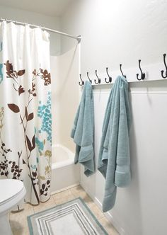Hooks for a kids bathroom instead of a towel bar makes it easier for the kids to hang their towel.