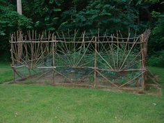 Handmade garden fence referred to as suburban-peasant-funk by builder. It's made of dead-fall wood and is 16' x 16'. Chicken wire is on the bottom two feet and buried one foot into the ground to keep the critters out -