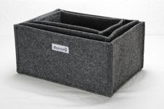 Set of 3 storage boxes  Colour: red, blue, green, violet, dark grey or light grey Material: felt (4mm) Dimensions (lenght x width x height):  1x ca.
