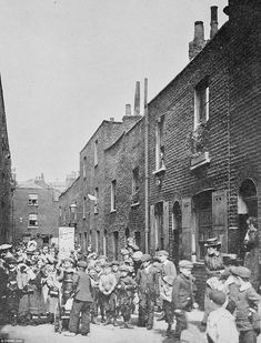 'Devonshire Place, London' shows a busy street filled with young children in Jack London's book 'People of the Abyss' about life in the East End of London in 1902
