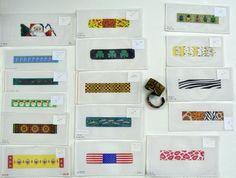 http://www.diversionsneedlepoint.com/wearable/bracelets.JPG