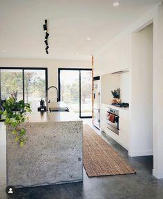 Concrete and white kitchen