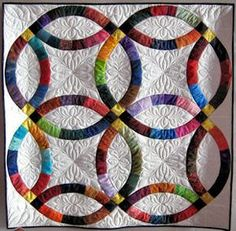Barbara Hartman - The Double Wedding Ring gained popularity in the 1930s and remains one of the most recognized quilt patterns today.