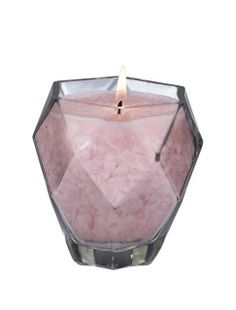 by Smart Living Company Gem lover and candle lovers this one's for you! Our 9-ounce Prism Jewel Candle featuring the Rose Quartz Scent, in one of our Crystal Jewel Glass Candles, is elegance personified. The icy pink candle, made with 100% eco-friendly palm wax, sits in a stunning clear glass container cut just like the finest crystal. It's a looker for sure, but it also has a captivating fragrance.