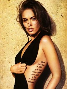 i want a tatoo like this with a bible verse. but i will never have the body for it.....sigh....a girl can dream