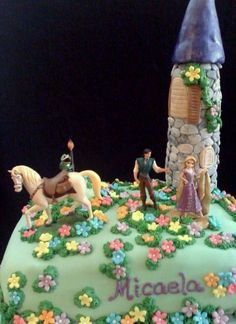 """Rapunzel Cake - Made this for a dear friend's daughter.  Castle is rice krispie treats covered in fondant """"stones"""".  Figures were provided by mom."""