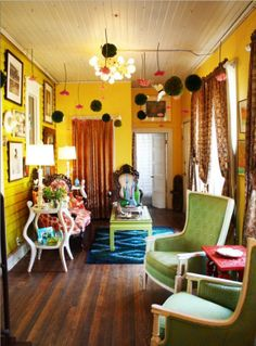 bohemian style living room in bright and cherry colors of yellow turquoise and green bohemian style living room