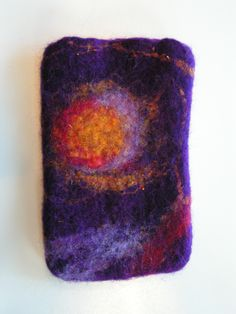 This is not a good example of a Felting Phone Case. It is not equal and doesnt look finished :(