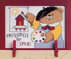 Look What I Did! Cross Stitch ePattern - Number of Designs: 1 Stitch Count: 87w x 65h Designer: Kooler Design Studio Original Publication: Leisure Arts Leaflet #2422,Look What I Did! Description: Boost a child's self-esteem by proudly displaying his handiwork clipped below this design. A charming bear artist presents the grand masterpiece with colorful flair. An alphabet is included for personalizing the design to identify the little artist. It was cross stitched on White Aida (14 count)…