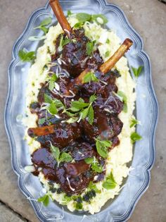 Jamie's Guinness lamb shank recipe is all about tender meat in a dark sticky sauce, which is made extra amazing by adding Guinness to the onions.