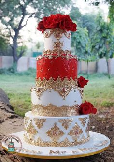 wedding cakes red A royal red and white cake adorned with golden appliqus and embellishments. A stunner all the way through. Wedding Cake Red, Indian Wedding Cakes, Floral Wedding Cakes, Elegant Wedding Cakes, Elegant Cakes, Beautiful Wedding Cakes, Gorgeous Cakes, Wedding Cake Designs, Indian Weddings