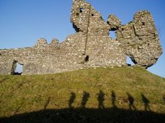 Ruins, Galway Photograph by Stephanie Spitzer, I spent four months at school in Galway, Ireland, and my archaeology class took a castle field trip. I captured this picture as the class was walking past the ruined castle. I love the fact that I got our shadows—it leaves some mystery as to who the figures walking past are.