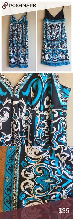$98 ECI 6 S Scarf Stretch Silk Babydoll Dress $98 ECI 6 S Scarf Print Stretch Silk Charmeuse Babydoll Dress Blue Paisley   Condition: Like NEW!   Sumptuous stretch silk charmeuse styles a slipdress, designed with adjustable spaghetti straps and a pleated Empire waist.  Beautiful jewel-tone blue paisley.  Color(s): Blue Black White  ECI Charmeuse Scarf Print Babydoll Dress.  93% Silk/ 7%spandex; machine wash.  Attached lining is form-fitting at bust; semi-fitting at hip.  Bust: 35 Waist: 34…