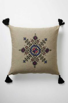 A Fesi pillow features a Moroccan design that echoes Scandinavian snowflake motifs. Moroccan Design, Moroccan Style, Embroidery Patterns, Hand Embroidery, Christmas Embroidery, Palestinian Embroidery, Vintage Typography, Vintage Logos, Retro Logos