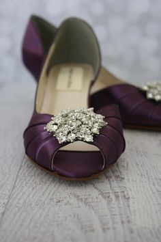 Dress up your walk down the aisle with these lovely d'orsay plum purple wedding shoes with a silver crystal brooch on the toe. These shoes may be ordered as shown, or custom designed by changing the base shoe color. The pricing does not change if you select different options. Custom Options:  Like it, but don't love it? We do design shoes to your specifications!! To view our options and learn more, please visit our website at: http://www.customweddingshoe.com/design/. Or, ...