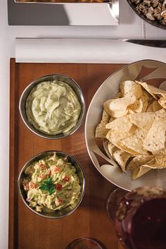 Dips and chips served with Tramontina Sour Cream, Palak Paneer, Dips, Ethnic Recipes, Food, Corn Chips, Guacamole Recipe, Bread Baskets, Snacks