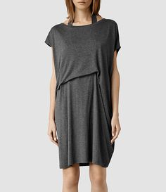 ALLSAINTS: The neck strap creates the drape at the waist.