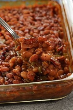This simple recipe with baked beans, brown sugar, bacon, peppers and onions is simple to put together, then bakes to develop all of the delicious flavors. Simple Baked Beans Recipe, Baked Beans With Bacon, Pork N Beans, Baked Bean Recipes, Bacon Recipes, Cooking Recipes, Chef Recipes, Crockpot Recipes