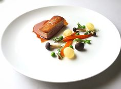Roasted duck breast, pommes soufflé, honey glazed carrots, peas, mushrooms