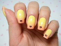 gradient yellow nail art with heart shaped rhinestones