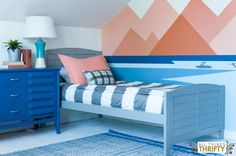 We love this mural on the wall!  What great choice of colors for this room!