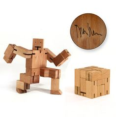 Cubebot® is a wooden toy robot inspired by Japanese Shinto Kumi-ki puzzles. Made from wood and elastic, Cubebot can be positioned to hold dozens of poses. Designed by David Weeks Studio for Areaware. Cubes, Contemporary Toys, Yellow Octopus, Gift For Architect, Wood Toys, Kids Furniture, Stocking Stuffers, Transformers, Gifts For Kids