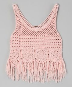 This groovy top brings a hippie-chic vibe to a gal's look, with its crocheted design and funky fringe. Its soft, cotton-blend construction slips on simply to create instant flower-child style.