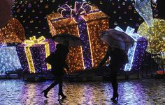 Here Comes Nick: Christmas Celebrations Around the World - NBC News.com  People walk past holiday decorations on a rainy evening in Warsaw, Poland, on Dec. 23.