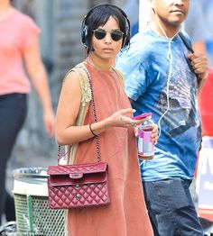 Healthy: The singer sipped on a bottle of Kombucha during her walk in the city...
