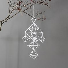 white himmeli mobile  in gold hanging from branches? Relates to wall string art