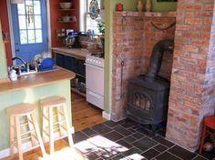 Living Room  Kitchen - Enesti | Tumbleweed Tiny House Company.   I love the…