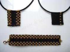 Collane e bracciale oro e nero in Cavandoli style